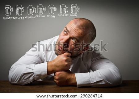 Man in white and beer. Alcoholism concept. Week by week, day by day. - stock photo
