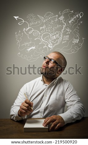 Man in white is ready to write something. Creativity. - stock photo