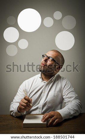 Man in white is ready to write something. Man having an idea with gray bubbles over his head.