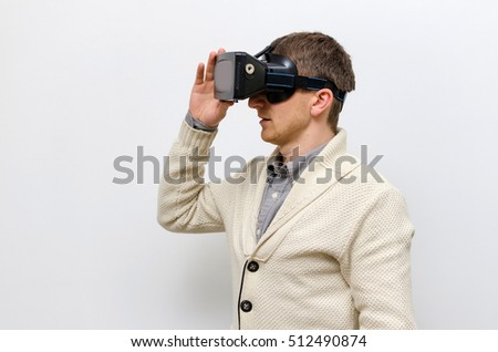 Man in white jacket wearing virtual glasses and turning to the right