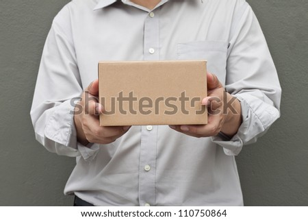 Man in white shirt carry recycle paper box hand under - stock photo