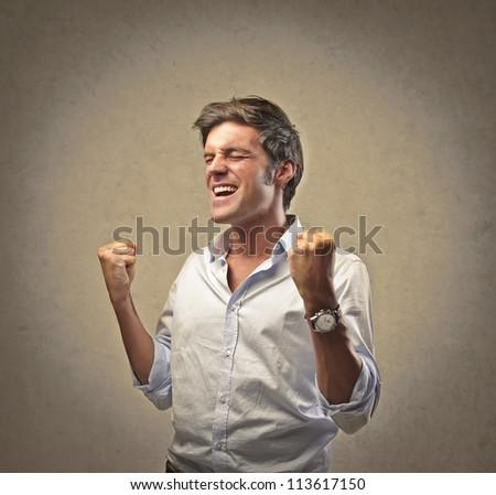 Man in white shirt exulting on a beige background - stock photo