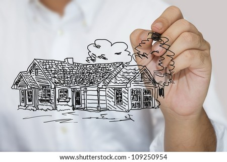 Man in white shirt sketching house