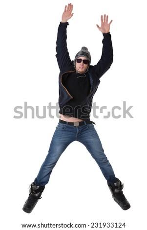 Man in winter wear jumping - stock photo