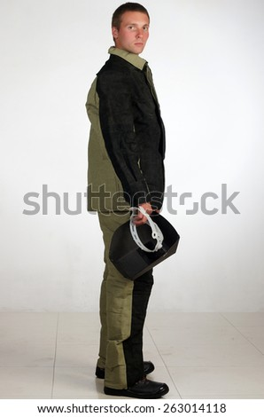 Man in work wear.isolated studio portrait - stock photo