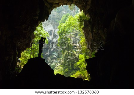 Man inside a cave - stock photo