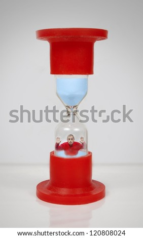 Man Inside The Hourglass - stock photo