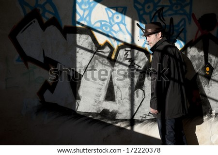 Man inspecting a dark room in an abandoned building