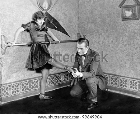 Man inspecting womans foot - stock photo