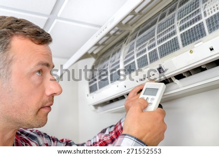 Man installing a new air conditioning unit