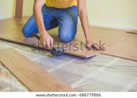 Man Installing New Wooden Laminate Flooring Stock Photo 100 Legal