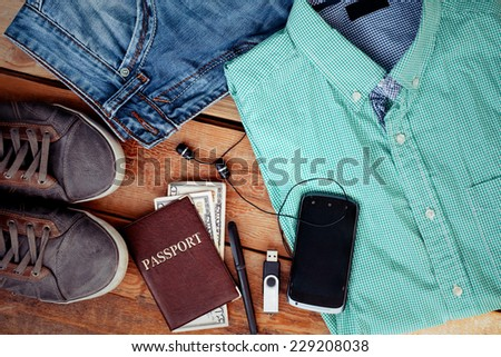 Man is accessories on a wooden background - stock photo
