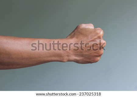 Man is acting in the fighting pose, right fist ready to fight - stock photo
