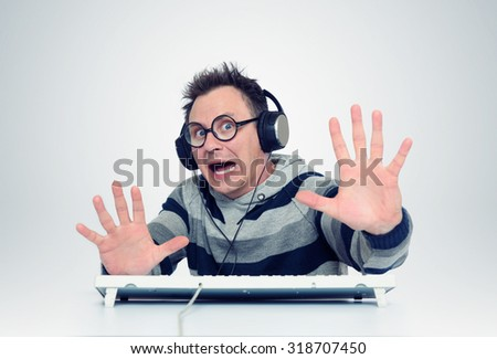 Man is afraid of sitting in front of computer