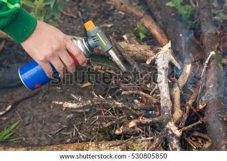 Man is burnt twigs with gas pocket