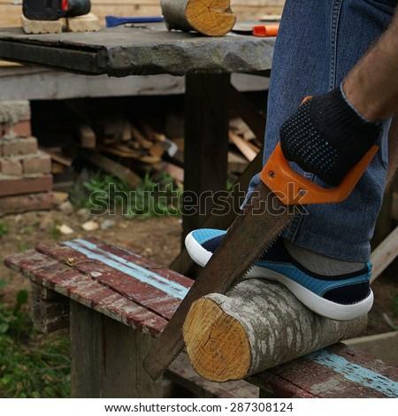 man is doing nag of  wood outside - stock photo