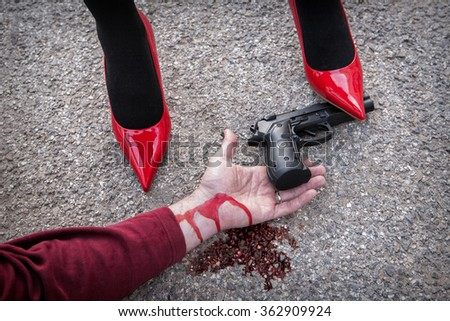 http://thumb1.shutterstock.com/display_pic_with_logo/1502369/362909924/stock-photo-man-is-dominated-by-a-woman-with-red-shoes-the-shoe-tread-gun-arm-bloodied-on-the-asphalt-362909924.jpg