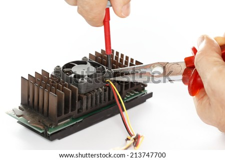 man is fixing an electrical component with gripper - stock photo