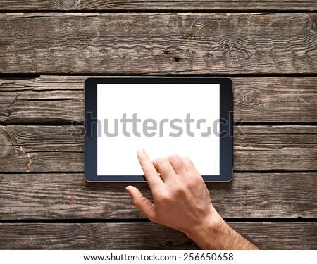 Man is going to touch screen of digital tablet. Clipping paths included.