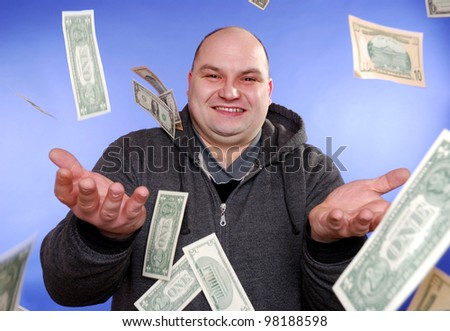 man is happy about a money rain - stock photo