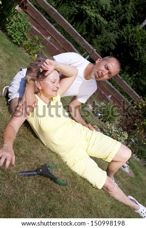 Man is helping old woman with heatstroke - stock photo