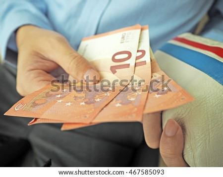 man is holding Euro banknotes with wallet, Euro bills.