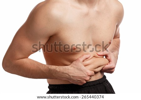 Man is holding fat on his belly over white background