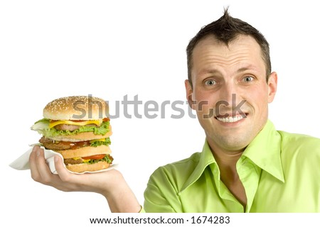 man is holding huge hamburger - stock photo