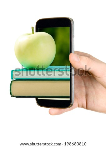 Man is holding mobile phone and showing book with apple - stock photo