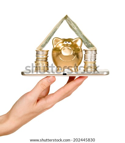 Man is holding mobile phone and showing piggy bank - stock photo
