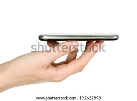 Man is holding smart mobile phone in his hand - stock photo