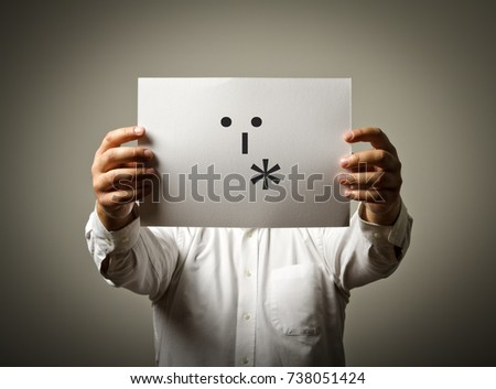 Man is holding white paper with smile. Kiss and love concept.