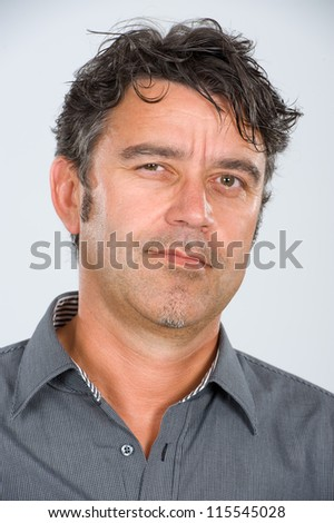 man is looking skeptical - stock photo