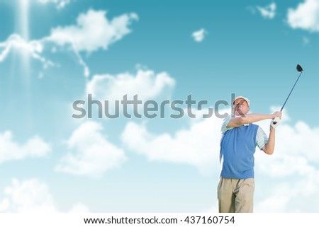 Man is playing golf against blue sky - stock photo