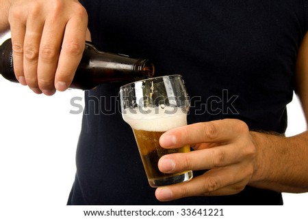 Man is pouring beer into glass isolated on white background