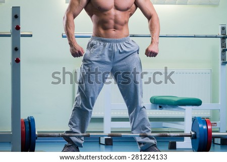 Man is ready to do the exercises. The exercises with a barbell. Sport, health, the concept of a healthy lifestyle.