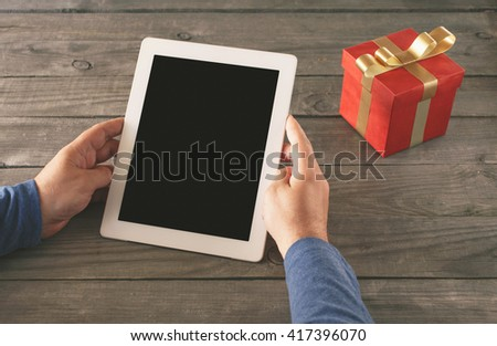Man is shopping through the Internet using a tablet computer. A man holding tablet with blank screen. - stock photo