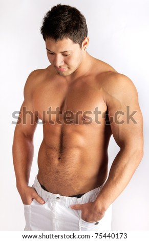 Man is showing his abdominal muscles