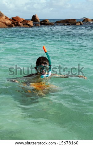 Man is snorkeling. Turquoise water. Sunlight