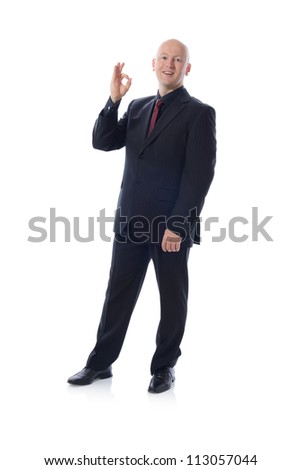 Man is suit giving the ok sign - stock photo