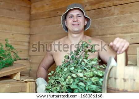 Man is taking a steam-bath  in sauna  - stock photo