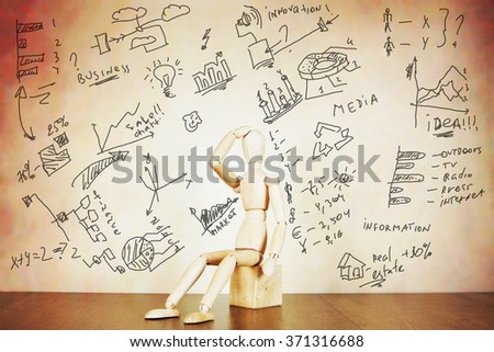 Man is tired because of too much data. Abstract image with a wooden puppet - stock photo