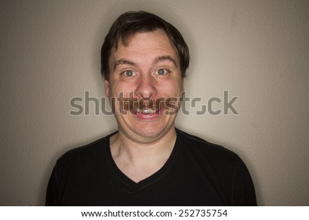 Man is too happy for something. - stock photo