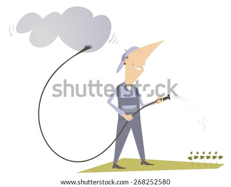 Man is watering a lawn with hose - stock photo
