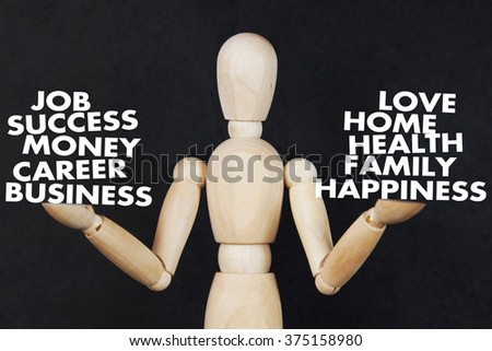 Man is weighing on his hands a career and family values. Abstract image with wooden puppet - stock photo