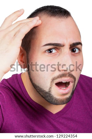 Man is worried about hair lossMan gets hair loss - stock photo