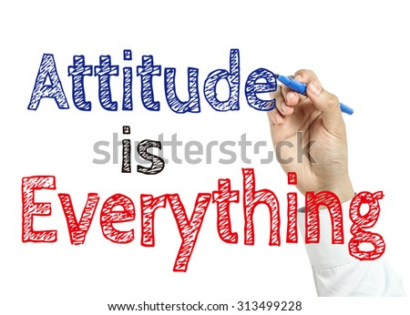 Man is writing text Attitude is Everything with marker on transparent wipe board. - stock photo