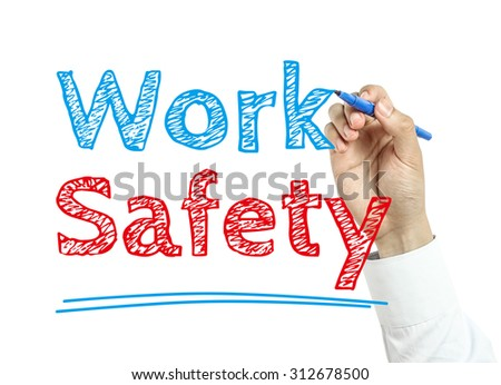 Man is writing text Work Safety with marker on transparent wipe board. - stock photo