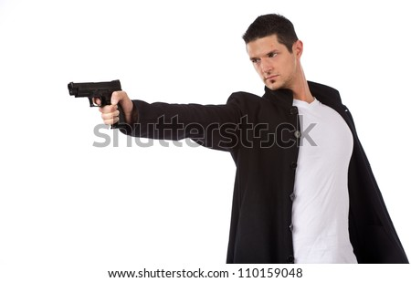 Man isolated on a white background with a handgun as he turns and aims off camera. - stock photo
