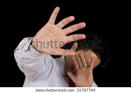 Man isolated on black hiding his head with the hands